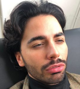 A client undergoing eyebrow grooming for men